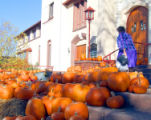 A woman makes her way between over a hundred Pumpkins on the steps of the First United Methodist...