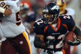 (CANTON, Ohio., SHOT 8/9/2004) The Denver Broncos' Quentin Griffin (#22) runs with the ball...