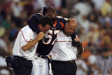 (CANTON, Ohio., SHOT 8/9/2004) The Denver Broncos' Jashon Sykes (#57) is helped off the field by...