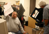 Dan Willis, cq, (lt) looks over a voting test boards, Thursday Oct. 19, 2006 to test voting...