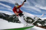 DLM05269   Andrew Steward, 20, of Vail slides down one of the rails in the Banana Terrain Park at...