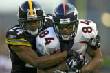 The Denver Broncos Javon Walker (#84, WR) hauls in a 38 yard pass reception in front of the...