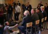 MJM517 Addressing the media during a press conference Sunday, Pastors, Tim Ralph, seated left to...