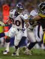 The Denver Broncos Mike Bell (#20, RB) looks for a hole against the Pittsburgh Steelers during the...