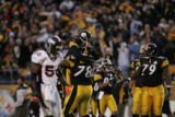 (JPM395)  Denver Broncos linebacker Al Wilson, #56, walks past Pittsburgh Steelers quarterback Ben...