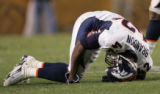 (JPM1267) In the fourth quarter, Denver Broncos Sam Brandon grimaces and holds his knee after...
