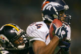 The Denver Broncos Javon Walker (#84, WR) hauls in his third touchdown of the game in front of the...
