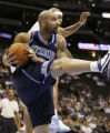 DXA103 - Utah Jazz forward Carlos Boozer, front, pulls down a rebound in front of Denver Nuggets...
