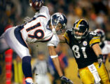 The Denver Broncos Brian Clark (#19, WR) goes airborne on a kickoff return as the Pittsburgh...