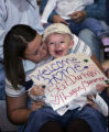 Summer Durham (cq) holds her son Logan, 19 months old, in her lap at a welcome home ceremony for...
