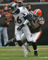 Denver Broncos quarterback Jake Plummer gets sacked by Cleveland Browns defender Alvin McKinley,...
