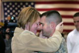 Sara Carvella (cq) holds  her husband, Staff Sgt. Shane Carvella (cq) for the first time in a year...