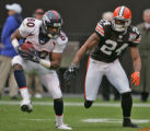 Denver Broncos wide reciever Rod Smith runs for a first down being defended by Cleveland Browns...