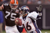 Denver Broncos quarterback Jake Plummer is chased after Cleveland Brown Defender Simon Fraser,...