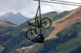 (SILVERTON, Colorado. July 23, 2004) A bike and pack are framed by the San Juans as they are...