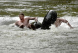Boulder, Colo., photo taken July 26, 2004-Jon Grinney (left), 21, and friend Jacob Cunningham,21,...