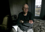 Robert Morlan (CQ), 86, sits in his room at the Sunrise Senior Living at Cherry Creek Monday...