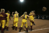 The Lobos celebrated after their win against the Farmers in 5A State Championshipds Rocky Mountain...