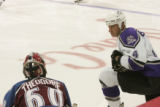 RMN1695 Los Angeles Kings Rob Blake, right, talks to Avalanche goalie Jose Theodore during the...