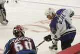RMN1698 Los Angeles Kings Rob Blake, right, talks to Avalanche goalie Jose Theodore during the...