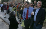 8:50 a.m. Bill Ritter, Democratic candidate for governor checks out the length of the line as he...
