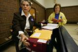 (Timeshot: 06: 12) Election judges Joyce Knutson (cq), left, and Darlene Cassel (cq ) prepare a...