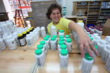 Cheryl Raff, (cq), New Connections employee, stocks the vitamin section. Vitamin Cottage, 2375...