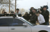 (BG0431} Media surround Steve Larsen's car, a family friend and New Life Church staff member, as...