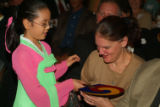 One of the choir members from Suwon Central Baptist Church in Seoul, South Korea presents a fan to...
