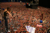 Melissa Kann, cq, Boulder, cleans up after an event at which Vice President Dick Cheney presided...