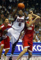 XIST102 - Team USA guard Dwyane Wade goes for basket as Turkey's center Hidayer Turkoglu, left,...