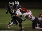 (DLM3454) -  Overland High School running back Jared Campbell breaks free of the Fairview High...