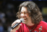 (JPM0253)  American Idol contestant and pop singer Ace Young sings the National Anthem before the...