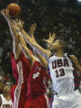 XIST106 - Team USA center Tim Duncan (13) battles for a rebound against Turkey's Serkan Erdogan,...