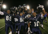 (DLM3938) -  The Overland High School football team erupts in celebration after defeating Fairview...