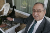 Tom Kelly, running as the Green Party candidate in the 1st congressional district pets his cat...