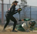 Pomona's Mona Booco, left, beats Mountain Vista's Amy McMullen, right, to the third base bag for...