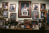 """Miss"" Mary Anthony's collection of her sons photographs and awards in the living room..."