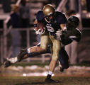JPM222  No. 1-ranked Mullen High School Mustangs senior wide receiver Dale Brooks, #9, drags No....