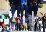 A trio of skiiers catch one of the first chairs up the mountain on the Exhibition lift as Arapahoe...