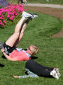 Kristen Reese (cq), top, does some stretching after she finished the half marathon in the Denver...