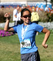 Ellen Ahn (cq) strikes a pose for a family photo after she finished the half marathon in the...