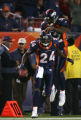 Champ Bailey and Ian Gold celebrate after Bailey's interception in the second quarter of the...