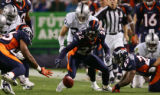 Darrent Williams fumbles the ball on a punt return in the third quarter of the Denver Broncos...