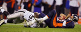 The Denver Broncos' Jake Plummer (#16, QB) is sacked by the Oakland Raiders' Derrick Burgess (#56,...
