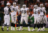 Oakland Raiders' Warren Sapp (#99, DT) and Tyler Brayton (#91, DE) try to plead their case to...