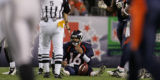 (RMN867) - Denver Broncos quarterback Jake Plummer, #16, sits on the grass after being sacked by...