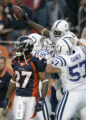 (BG611) Denver Broncos Darrent Willams is dejected as the man he was covering, Indianapolis Colts...