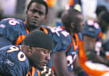 (MAP1084)The Denver Broncos Kenny Peterson (#90, DE) and the rest of the Broncos' defense sits...