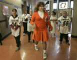 Denver School of the Arts Assistant Principal Pete Castillo (cq), dressed as a cheerleader for...